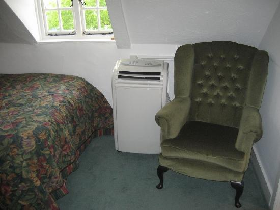 Hook House Hotel: Comfy chair and air conidtioning unit.