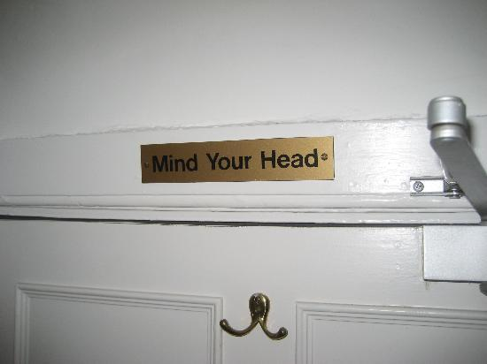 Hook House Hotel: 'Mind you head' sign over door, also applicable in other parts of the room.
