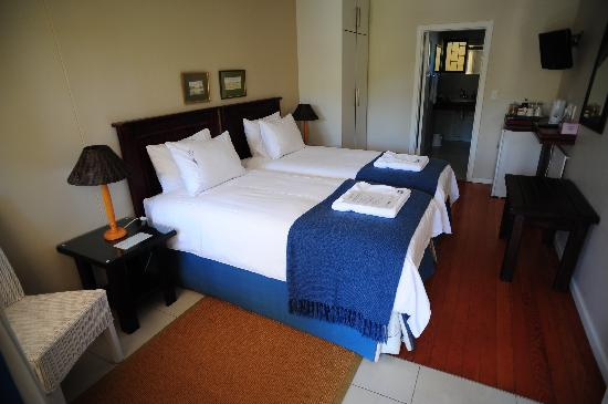 Cornerstone Guesthouse: Our room, blue and white, dark woods, lavender