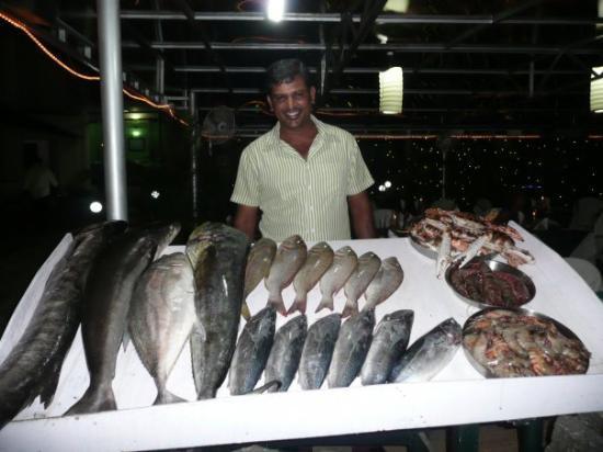 Beach Hotel Neelakanta: my favourite waiter Subash, at hotel Neelakanta with the catch of the day