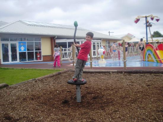 Thorpe Park Holiday Park - Haven: My son in the park - you can see the splash zone in the background
