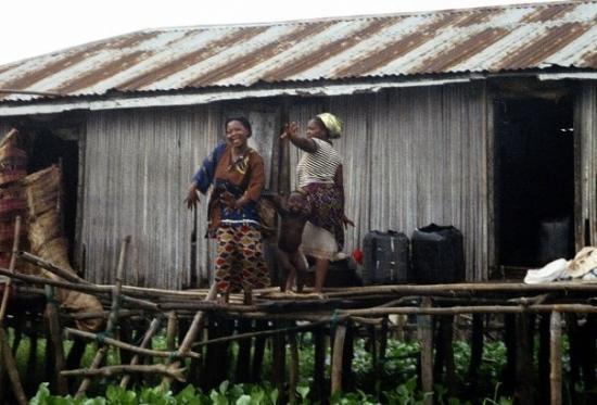 People dancing outside their house on stilts. Ganvie, Benin 24.12.08
