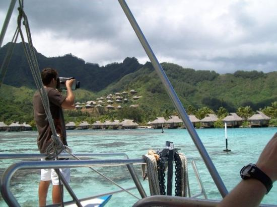 Filming the DVD of our adventures on Moorea Island. Note the coral in the clear water.