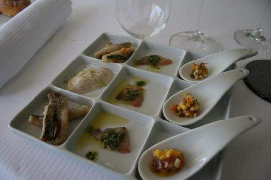 Le Petit Nice: Our first course. Little sardines, tuna and local vegetables on a spoon.