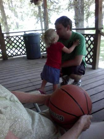 Tilden, IL: Makayla kissin her Daddy on Granny's front porch