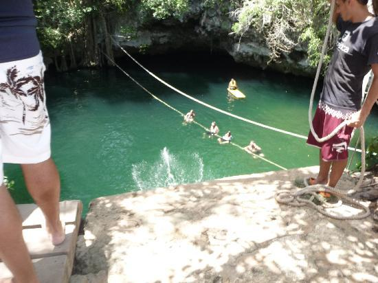 Selvatica: swimming in the Cenote(natural sinkhole-fesh water)