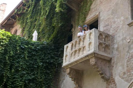 Casa di Giulietta: A father and daughter pose on the balcony immortalized by Shakepeare in 'Romeo & Juliet.' There