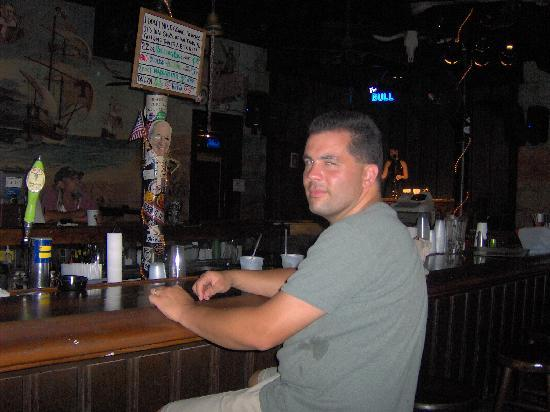 The Bull And Whistle Bar: My husband having a drink!