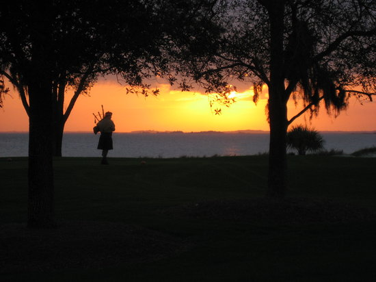 The Lodge at Sea Island: Bagpiper at sunset