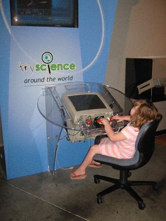 Museum of Science & Technology (MOST): No idea what he was doing but she liked it!