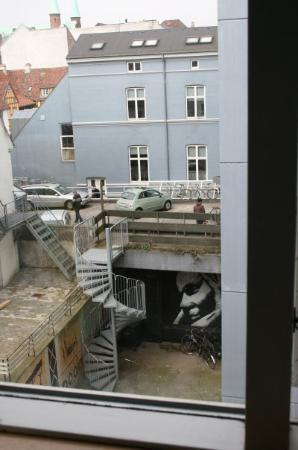 City Sleep-In: View from my hostel window. The garden had some mad murals.