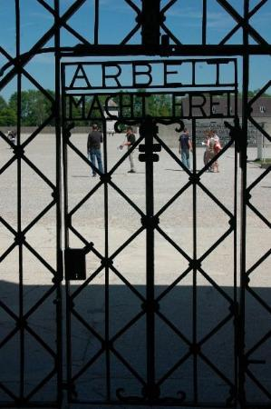"""Dachau Concentration Camp Memorial Site: This is the front gate from Dachau.  It says """"work makes you free,"""" but we all know that was a l"""