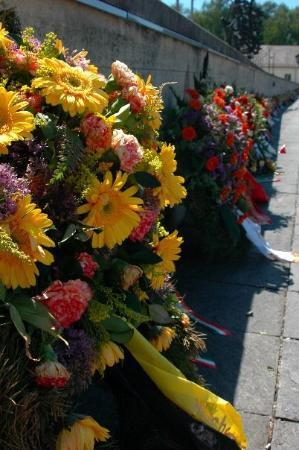 Dachau Concentration Camp Memorial Site: memorial flowers at Dachau