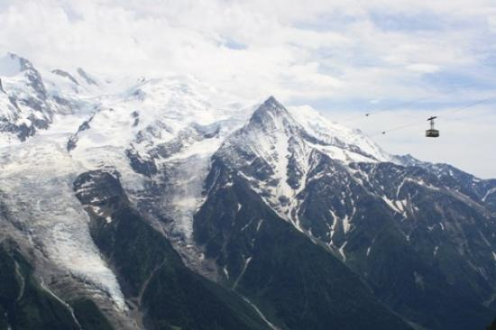 """Le Brevent Cable Car: Cablecar in front of the Mont Blanc (meaning """"white mountain"""") - the highest mountain in the Alp"""