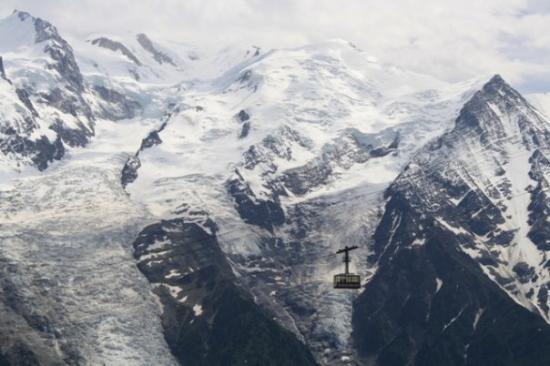 "Téléphérique du Brévent : Cablecar in front of the Mont Blanc (meaning ""white mountain"") - the highest mountain in the Alp"