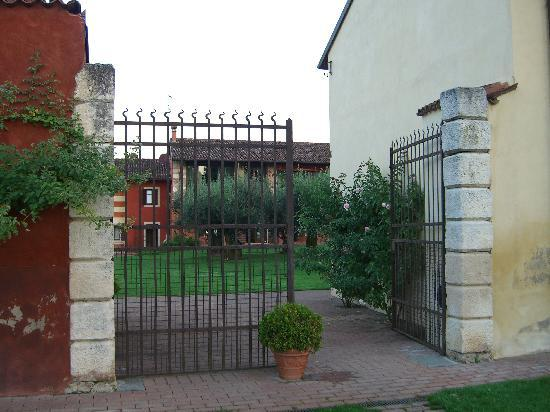 Musella Winery & Country Relais: The courtyard entrance. There's also a larger, sturider automatic gate at the driveway entrance.