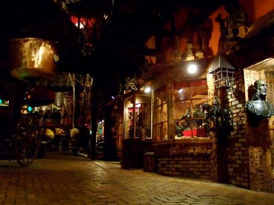 "House on the Rock: One of the dimly lighted streets of yesterday, with ""why is that here?"" displays"