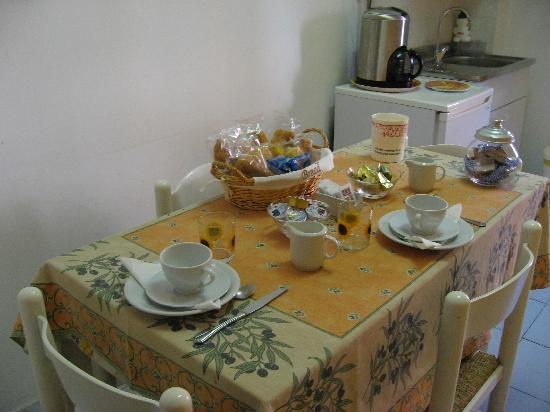That's Amore Holidays Hotel: A lovely cheeful, bright kitchen where breakfast is served. The space is also avail for lunch