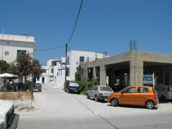 Hotel Milos: The view of the main entrance, past abandoned buildings.