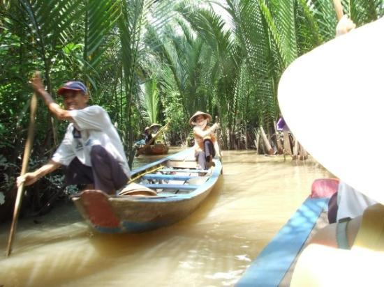 boat ride down canals in mekong delta