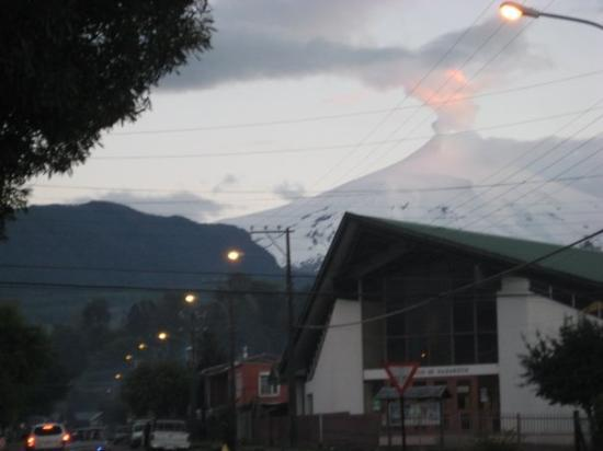 Pucon.  The volcano is smoking, and in catching the last rays of the setting sun, it gives the a