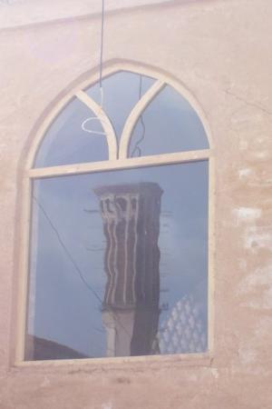 Yazd, อิหร่าน: Badgir reflected in window.