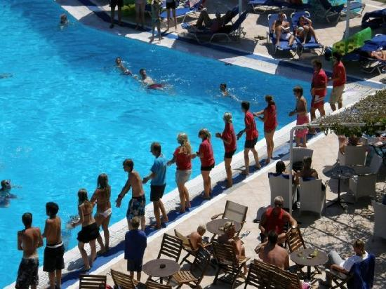 Mitsis Ramira Beach Hotel: The animation team at the pool doing their 3pm dance! The kids loved it!