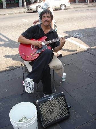 Cafe Du Monde: This dude cleans up outside and adds to the Atmosphere