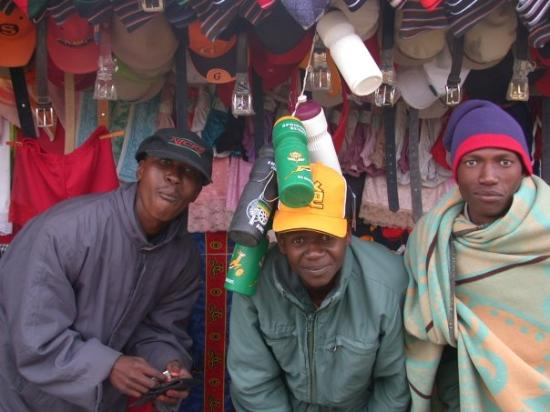 Mohales Hoek, Lesotho: Three shanty merchants in Mohale' Hoek one wears the Nick's cap from Walforf.