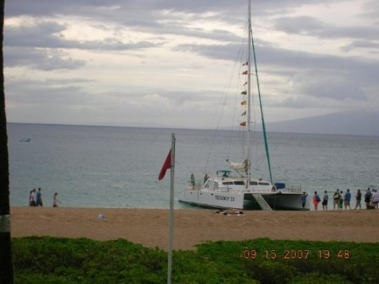 Trilogy cruise loading passengers on beach in front of Ka'anapali Beach Hotel, Lahaina, Hawaii..