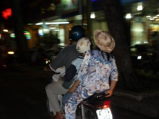 โฮจิมินห์ซิตี, เวียดนาม: An extremely common sight, 3 people on a motorbike (sometimes even 4) and nearly always without