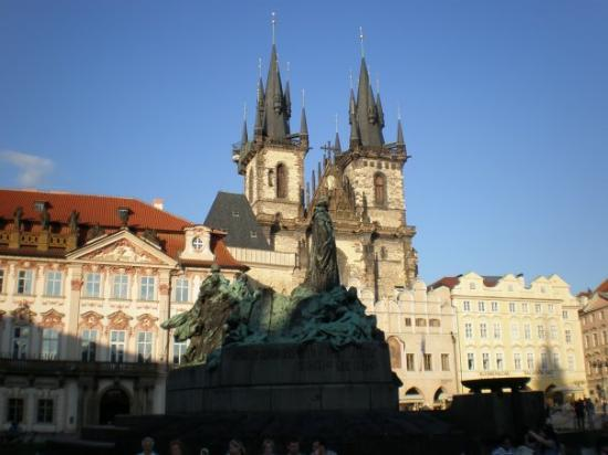 Statue in Old Town Square with Church of Our Lady Before Tyn in background.