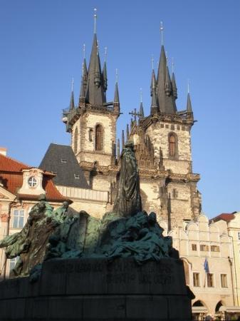 Statue and church in Old Town Square