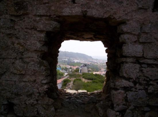 Obidos Village: Looking through a hole in the wall in obidos, looking out at an abandoned windmill. 8/17/09