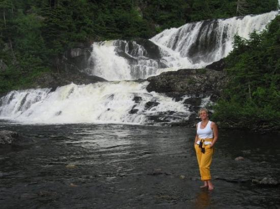 Sherry, posing in front of Baker Brook Falls, in Gros Morne National Park, Newfoundland (Jul 05)