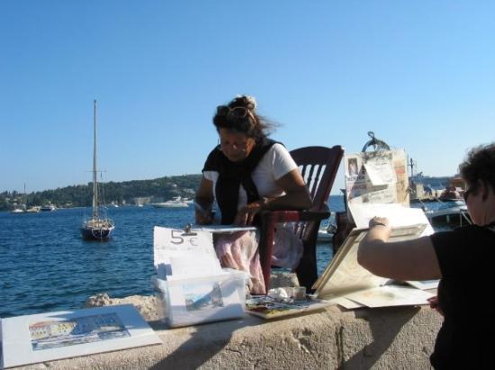 Villefranche-sur-Mer, ฝรั่งเศส: An artist on the Villefranche waterfront (Oct 06).