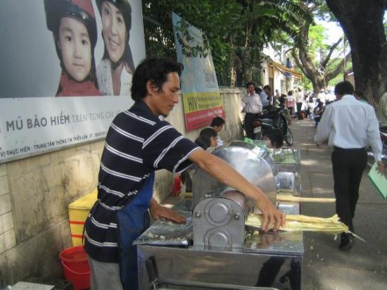 โฮจิมินห์ซิตี, เวียดนาม: Our nuoc mia guy.  We get sugarcane juice from him so often that he waves when he sees us now.