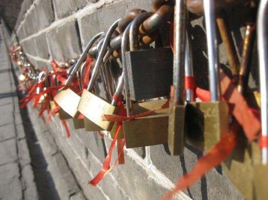 The Great Wall at Badaling: a couple could buy a love lock, hang it on the string and throw the key away so that their love
