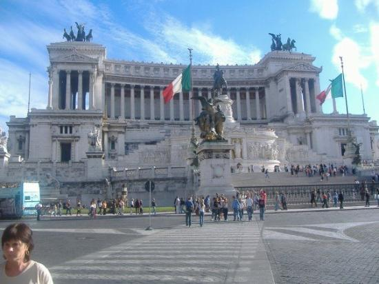 Piazza Venezia: Piazza di Venezia.  It's huge, and Kelly said you're not allowed to sit on the steps.  The polic