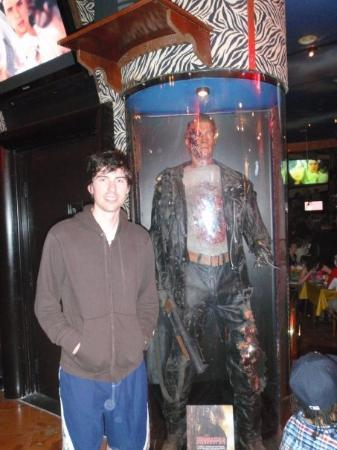 Daniel next to the Terminator at Planet Hollywood.