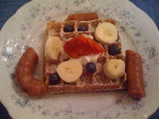 Red Bluff Cottage: From scratch wild rice waffles, fruit, and Conecuh sausage (starter was sweet baked apples)