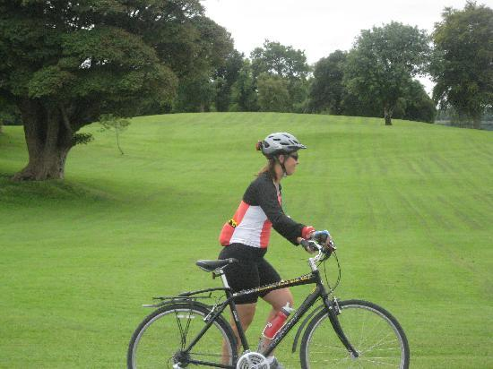 Ross Castle: A rider walking her bike past the lawn