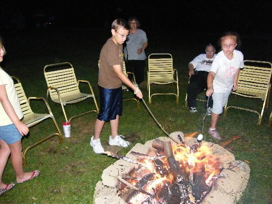Profile Motel & Cottages: sharing s'mores with new friends