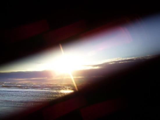 พอร์ตแอรานซัส, เท็กซัส: Port Aransas, TX  2008  sun up at the coast, but the lens did not open all the way....thought