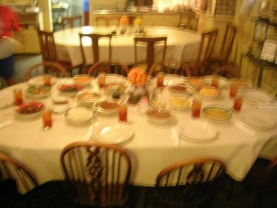 Mrs. Wilkes Dining Room: Mrs. Wilkes' Boarding House. Lunch is served: BBQ ribs, fried chicken, taters, dirty rice, mac &
