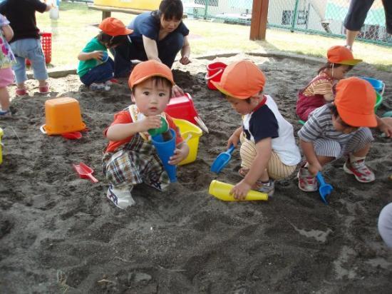 Misawa, ญี่ปุ่น: Playing in the sandbox with his buddies.
