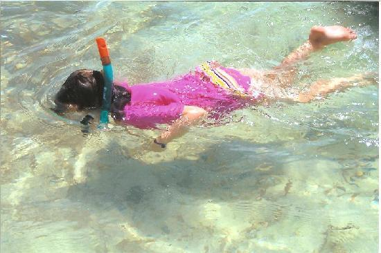 Isla Mujeres Palace: my daughter snorkling