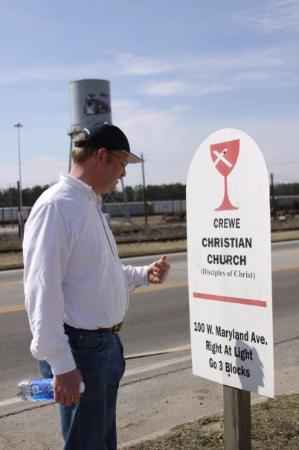 Crewe, VA: Jim looking at the church sign next to the highway.