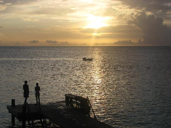 Sunset view of dock at Captain Don's Habitat