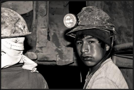 Young miner at the silver mine in Potosi chewing maybe 200 leaves of coca in his left cheek